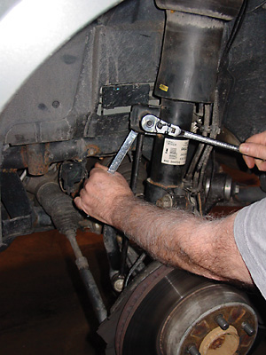 Figure 3 - removing nut securing the stabilizer bar link to the damper