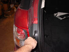 remove the left tail light assembly