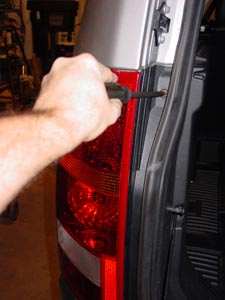 take out screws to remove tail light