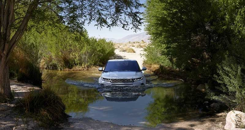Land Rover Evoque fording a river