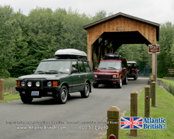 Land Rovers coming out of covered bridge
