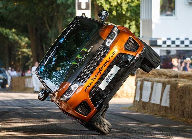 Range Rover Sport on side wheels