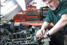 technician working on Land Rover engine